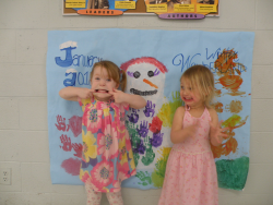 Two Toddlers Show off Their Artwork