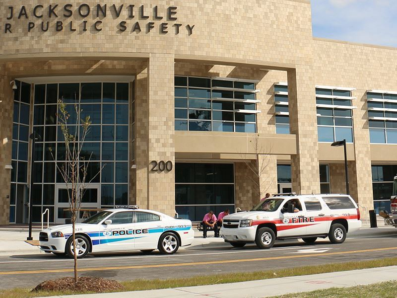 Police cars and firetruck in front of Jacksonville Public Safety building